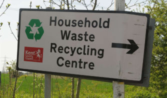 Sign pointing to recycling centres